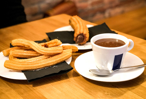 """Try the famous Spanish """"churros con chocolate"""""""